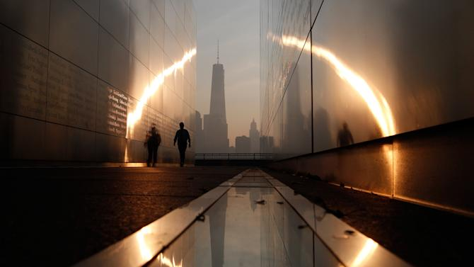 A man walks through the 9/11 Empty Sky memorial across from New York's Lower Manhattan and One World Trade Center in Liberty State Park