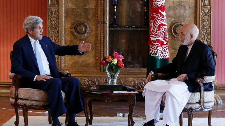 U.S. Secretary of State Kerry meets with Afghanistan's incumbent President Karzai at the presidential palace in Kabul