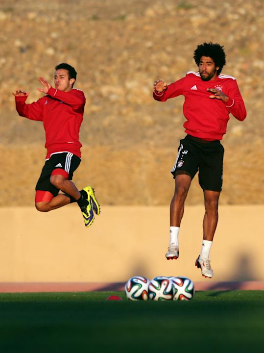 Bayern's Thiago Alcantara of Spain, left, and teammate Dante of Brazil warm up during a last training session at the Club World Cup soccer tournament in Marrakech, Morocco, Friday, Dec. 20, 2013.