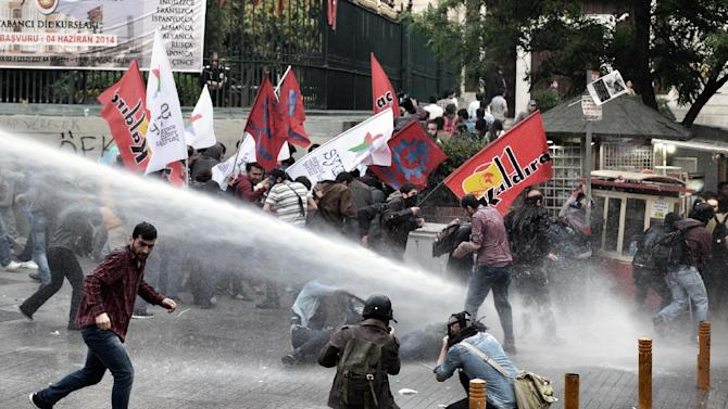 Riot police use water cannons and teargas to disperse people who were protesting the Soma mine accident that killed 301 miners, in Istanbul, Turkey, Saturday, May 17, 2014. Turkey's Energy Minister Taner Yildiz said Saturday that crews had found more bodies overnight, raising the death toll to 301. An explosion and fire at a coal mine in Soma, some 250 kilometers (155 miles) south of Istanbul, killed hundreds of workers in one of the worst mining disasters in Turkish history. (AP Photo