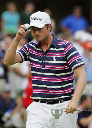 Webb Simpson tips his hat on the 15th green during the first round of the Wells Fargo Championship golf tournament at Quail Hollow Club in Charlotte, N.C., Thursday, May 3, 2012. (AP Photo/Gerry Broome)