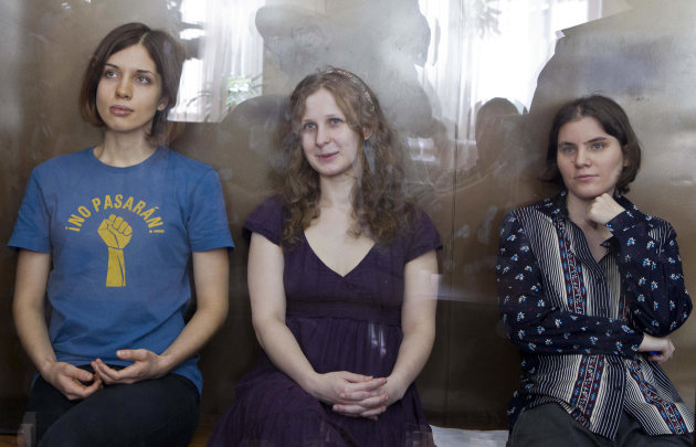 "FILE - In this Wednesday, Aug. 8, 2012 file photo feminist punk group Pussy Riot members, from left, Nadezhda Tolokonnikova, Maria Alekhina and Yekaterina Samutsevich sit in a glass cage at a court room in Moscow, Russia. The Russian Orthodox Church on Sunday Sept. 30, 2012, asked for clemency for three jailed members of the rock band Pussy Riot if they repent for their ""punk prayer"" for deliverance from President Vladimir Putin at Moscow's main cathedral, a statement that came a day before an appeal hearing and appeared to reflect a desire to put an end to the case that has caused an international outrage. (AP Photo/Misha Japaridze, file)"