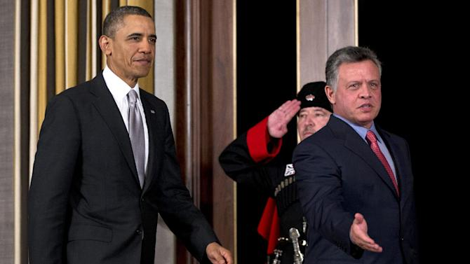 President Barack Obama and Jordan's King Abdullah II arrive for a joint news conference at the King's Palace, Friday, March 22, 2013, in Amman, Jordan. (AP Photo/Carolyn Kaster)