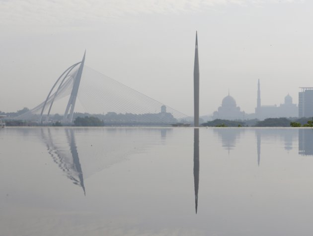 Malaysia's landmarks, Wawasan Bridge, Millennium Monument, Putra Mosque and the office of prime minister Putra Perdana are shrouded with haze in Putrajaya