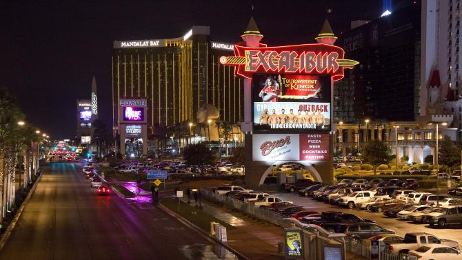 The marquee for the Excalibur hotel-casino is seen along Las Vegas Boulevard, Friday, Dec. 14, 2012, in Las Vegas. At around 8:30 p.m., a man shot a woman, who was a vendor at the hotel's concierge desk, and then turned the gun on himself. The man was found dead at the scene. The woman was transported to a local hospital, where she was pronounced dead. (AP Photo/Julie Jacobson)