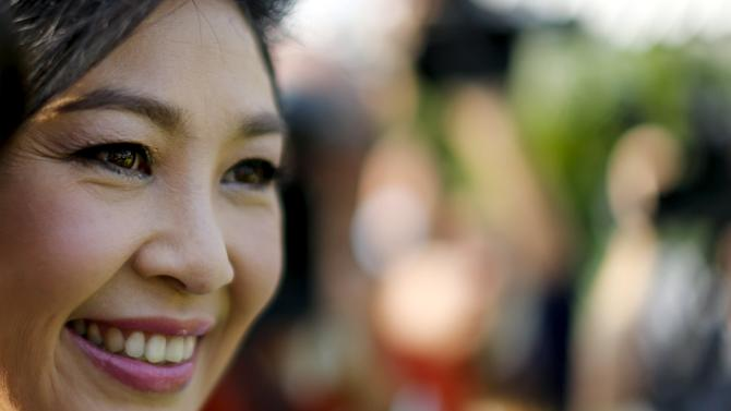 Ousted former Thai PM Yingluck Shinawatra stands while receiving foreign media at her vegetables garden at her house in Bangkok