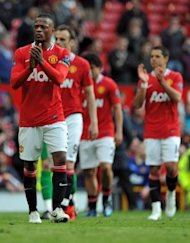 Manchester United's Patrice Evra (L) applauds the supporters after their 2-0 win in the English Premier League match against Swansea, at Old Trafford in Manchester, on May 6. Man United won 2-0