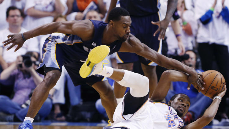 Oklahoma City Thunder's Kevin Durant slips and falls as Memphis Grizzlies Tony Allen blocks his pass during the final seconds of Game 2 of their Western Conference Semifinals NBA basketball playoff series in Oklahoma City, Tuesday, May 7, 2013.  (AP Photo/Alonzo Adams)