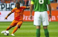 Dutch Wesley Sneijder (L) kicks the ball to score against Northern Ireland in Rotterdam. Netherlands won 6-0