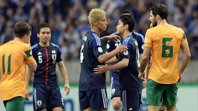 Japan's midfielder Keisuke Honda (C) and forward Shinji Kagawa (2nd R) celebrate the team's qualificationfor the World Cup after drawing with Australia in Saitama (AFP)