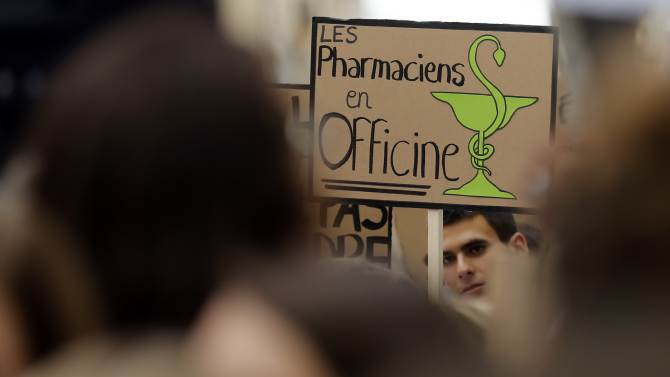 A pharmacist attends a national protest against a government reform plan to deregulate their profession in Marseille