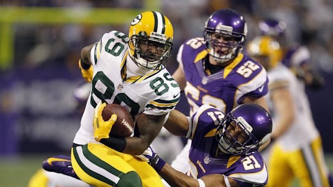 Green Bay Packers wide receiver James Jones (89) looks to break a tackle by Minnesota Vikings cornerback Josh Robinson (21) after making a reception during the first half of an NFL football game Sunday, Dec. 30, 2012, in Minneapolis. (AP Photo/Genevieve Ross)