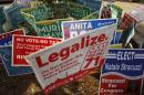 File photo of DC Cannabis Campaign sign with other signs in Washington