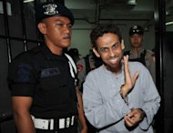 "Indonesian terror suspect Umar Patek gestures towards journalists after his trial in Jakarta on May 3. A suspected bombmaker dubbed ""Demolition Man"", arrested in the Pakistani town where Osama bin Laden was killed, is to testify Monday on his role in Indonesia's deadliest attacks -- the 2002 Bali bombings"
