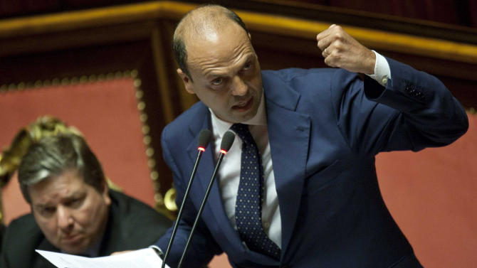 Interior Minister Angelino Alfano gestures as he informs the Senate on the botched deportation of the wife and 6-year-old daughter of a businessman who is a foe of Kazakhstan's government, in Rome Tuesday, July 16, 2013. Calls are mounting for Silvio Berlusconi's top political aide to resign as interior minister, but he insisted he knew nothing about Kazakhstan's diplomats urging lower-level ministry officials to deport Mukhtar Ablyazov's family from their Rome home in May. (AP Photo/Mauro Scrobogna, Lapresse) ITALY OUT
