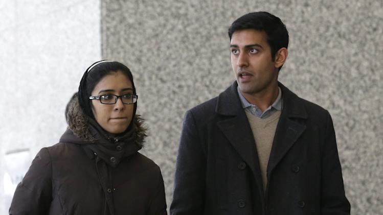The son and daughter of Chicago businessman Tahawwur Rana leave after their father's sentencing in federal court Jan. 17, 2013 in Chicago. U.S. District Court Judge Harry D. Leinenweber sentenced Rana to 14 years for his role in aiding a terrorist group that took credit for the deadly 2008 attacks in Mumbai, India. Rana was cleared in 2011 of involvement in the Mumbai siege that killed more than 160 people, but he was convicted of lesser charges. They included providing material support to a Pakistani militant group that took responsibility for the Mumbai attack and a planned attack in Denmark. (AP Photo/M. Spencer Green)