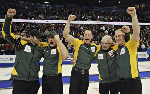 Members of team Northern Ontario celebrate winning the gold medal game over Manitoba at the Canadian Men's Curling Championships in Edmonton