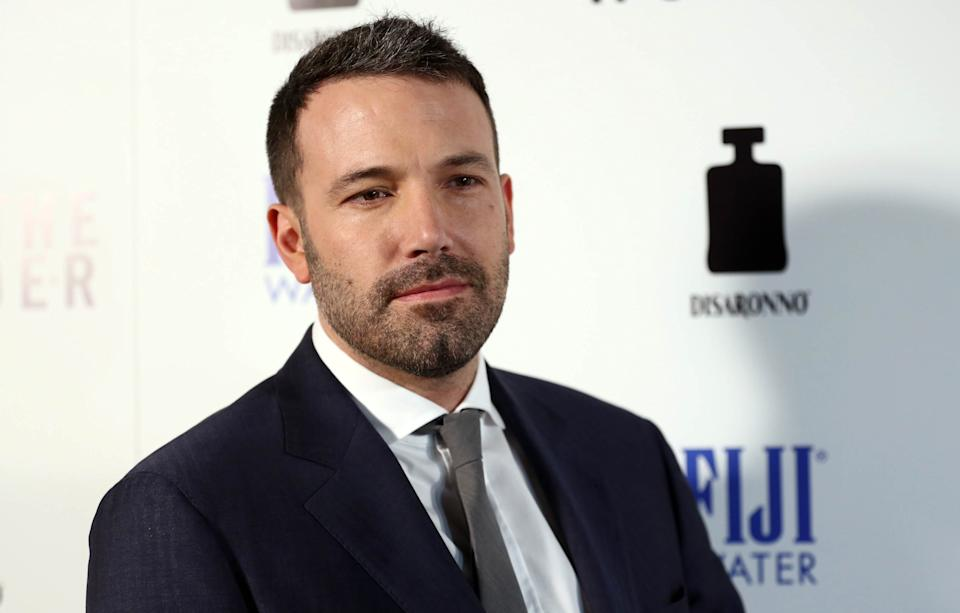 "FILE - In this Tuesday, April 9, 2013 publicity photo provided by Fiji Water, actor Ben Affleck arrives at the premiere of ""To The Wonder"" hosted by FIJI Water, in Los Angeles. Affleck discusses his awkward Oscar speech and remembers film critic Roger Ebert at the premiere. (AP Photo/Fiji Water, Matt Sayles)"