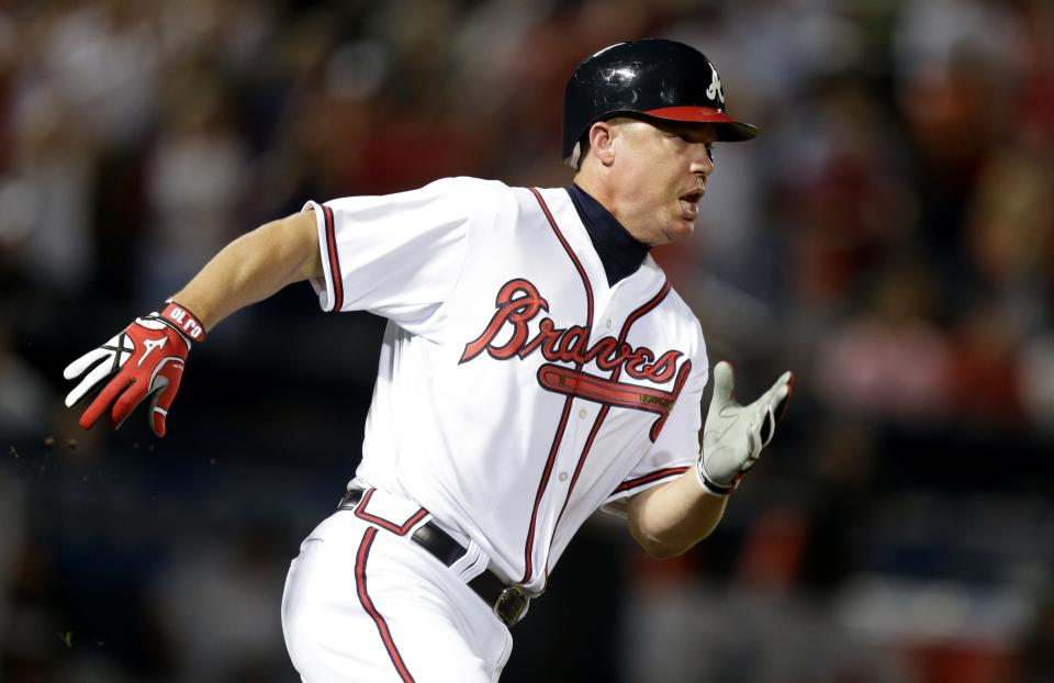 Atlanta Braves' Chipper Jones runs on a double during the ninth inning of a baseball game against the Miami Marlins on Tuesday, Sept. 25, 2012, in Atlanta. The Braves beat the Marlin 4-3 to clinch at least a wild-card berth. (AP Photo/David Goldman)