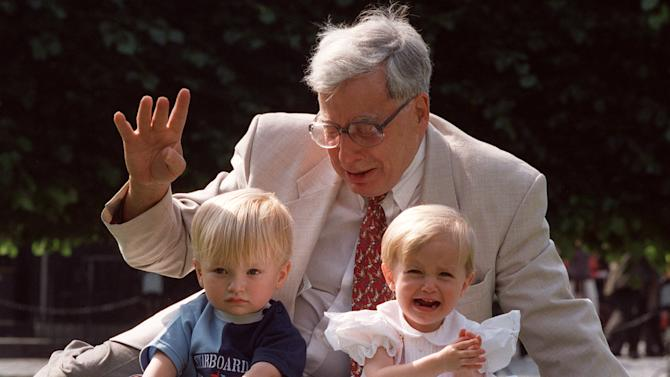 FILE- The British pioneer of IVF treatment, Professor Robert Edwards sits with two of his 'test-tube-babies', Sophie and Jack Emery who celebrate their second birthday in London in this file photo dated Monday July 20, 1998. The Nobel prize winner for medicine,  Edwards who was a pioneer of in-vitro fertilization, which became known as test tube babies, has died aged 87, it is announced Wednesday April 10, 2013. (AP Photo/Alastair Grant, File)