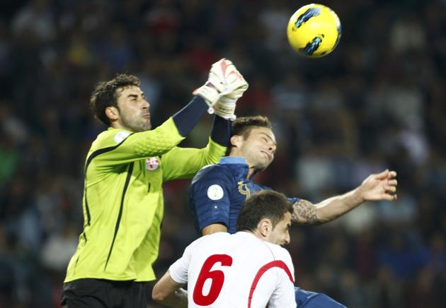 Georgia's goalkeeper Giorgi Loria and Akaki Khubutia fight for the ball with France's Olivier Giroud during their 2014 World Cup qualifying soccer match at the Boris Paichadze National Stadium in Tbil