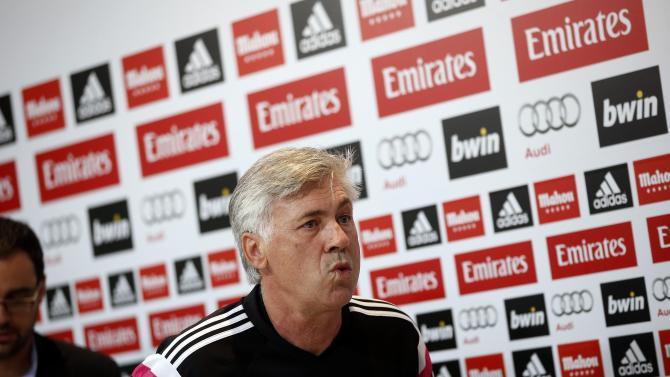 """Real Madrid's coach Ancelotti leaves after a news conference on the eve of their Spanish first division """"Clasico"""" soccer match against Barcelona in Madrid"""