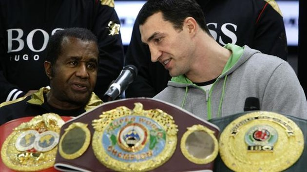 Heavyweight title holder boxer Vladimir Klitschko of Ukraine chats with his coach Emanuel Steward (Reuters)