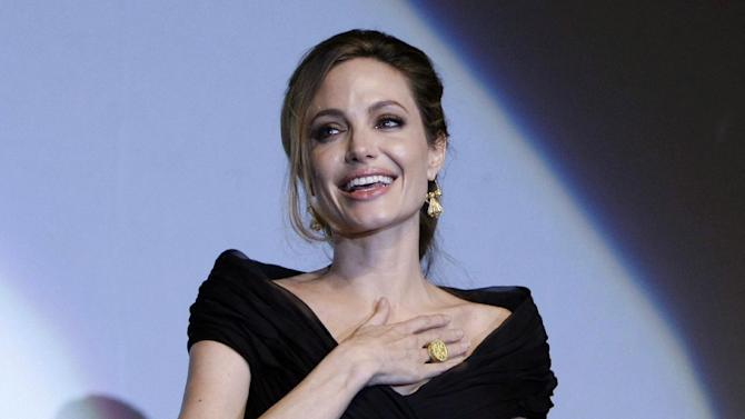 """FILE - This Feb. 14, 2012 file photo shows US actress and director Angelina Jolie addressing the audience after premiere of her movie, """"In the Land of Blood and Honey,"""" in  Sarajevo,  Bosnia. Jolie says that she has had a preventive double mastectomy after learning she carried a gene that made it extremely likely she would get breast cancer. The Oscar-winning actress and partner to Brad Pitt made the announcement in  an op-ed she authored for Tuesday's New York Times under the headline, """"My Medical Choice."""" She writes that between early February and late April she completed three months of surgical procedures to remove both breasts. (AP Photo/Amel Emric, file)"""