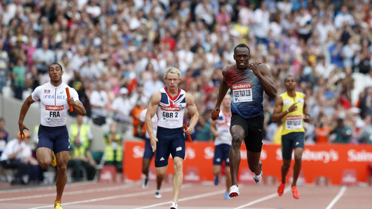 Jamaica's Usain Bolt, third left, runs en route to crossing the line to win the men's 400m relay for his team Racers Track Club during the Diamond League athletics meet at the stadium in the Queen Elizabeth Olympic Park, London, Saturday, July 27, 2013. The athletics meet marks the anniversary of the London 2012 Olympic Games. (AP Photo/Matt Dunham)