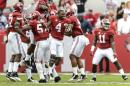 Alabama linebacker Reggie Ragland (19) celebrates his interception, which ended Texas A&M's best chance to score, with teammates during the third quarter of an NCAA college football game Saturday, Oct. 18, 2014, in Tuscaloosa, Ala. (AP Photo/AL.com, Vasha Hunt) MAGAZINES OUT
