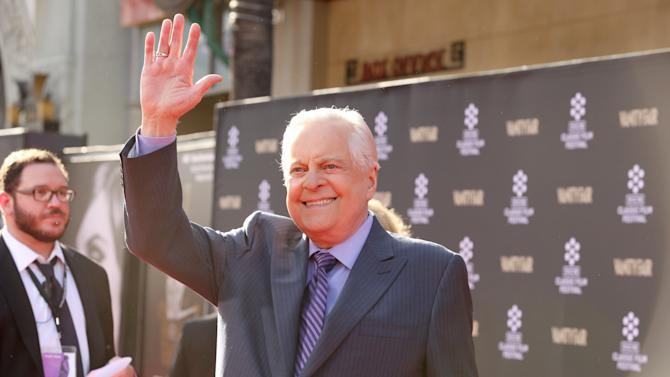 Host Robert Osborne at the 2013 TCM Classic Film Festival's Opening Night Gala at the TCL Chinese Theatre on Thursday, April 25, 2013 in Los Angeles. (Photo by Alexandra Wyman/Invision/AP)