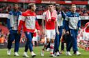 (L-R) Arsenal's Chuba Akpom, Nacho Monreal, Hector Bellerin, Danny Welbeck and Calum Chambers thank the crowd at the end of their English Premier League match against West Bromwich Albion at the Emirates Stadium on May 24, 2015