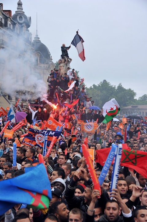 Montpellier's Football Club Supporters Celebrate With Players (not Pictured), At The Place De La Comedie On May 21, AFP/Getty Images