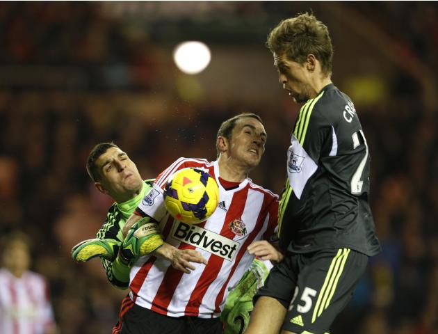 Sunderland's goalkeeper Mannone and O'Shea challenge Stoke City's Crouch during their English Premier League soccer match at the Stadium of Light in Sunderland