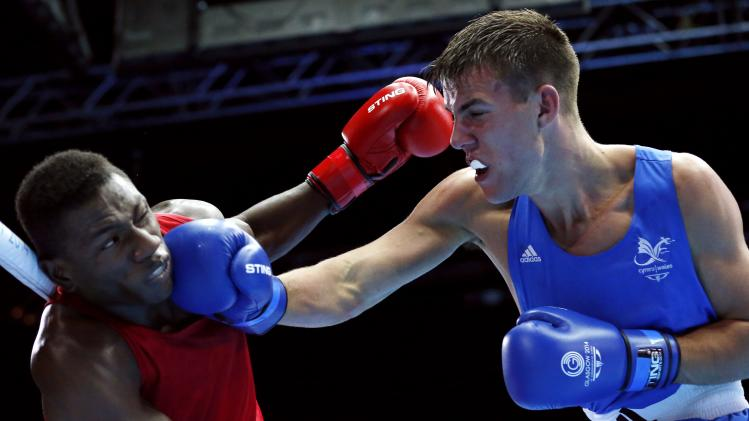 Wales' Thorley exchanges punches with Mauritius' St. Pierre during their men's Light Heavy Weight semi-final boxing match at the 2014 Commonwealth Games in Glasgow