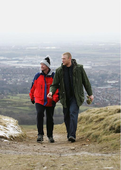 RIVINGTON MOOR, ENGLAND- MARCH 5:  England Cricketer Andrew Flintoff (L) is seen with Lancashire Physio Dave Roberts whilst on a walk on the Lancashire moors as part of his fitness training March 14,
