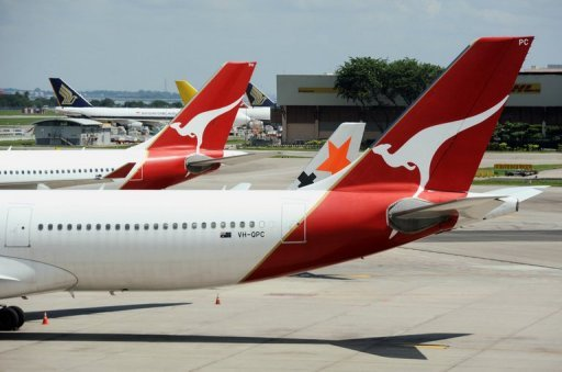 <p>Qantas planes sit on the tarmac at Singapore's Changi Airport. Singapore's Trade Minister Lim Hng Kiang on Monday acknowledged the city-state would be impacted by Qantas's tie-up with Emirates but said the air hub was looking to growth in Asia travel.</p>