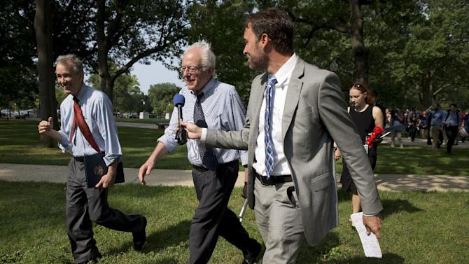A reporter asks questions of Democratic presidential candidate, Sen. Bernie Sanders, I-Vt., center, as he leaves a rally of registered nurses and other community leaders on the 50th anniversary of Medicare and Medicaid,Thursday, July 30, 2015, on Capitol Hill in Washington. (AP Photo/Jacquelyn Martin)