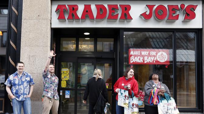 Employess greet people outside of Trader Joe's on Boylston Street in Boston, Wednesday, April 24, 2013, as businesses opened and traffic was allowed to flow all the way down Boylston Street for the first time since two explosions at the Boston Marathon on April 15. (AP Photo/Michael Dwyer)
