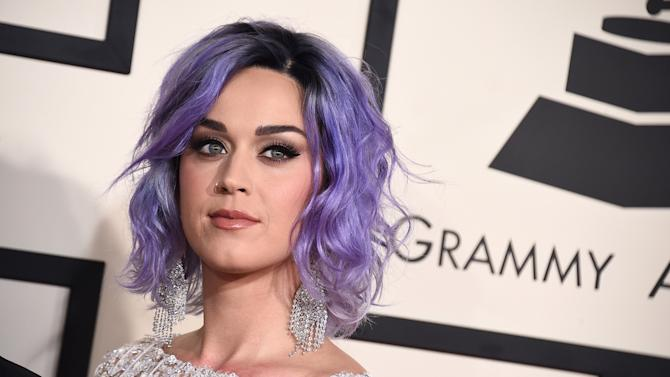 FILE - In this Feb. 8, 2015 file photo, Katy Perry arrives at the 57th annual Grammy Awards at the Staples Center in Los Angeles. A dispute between a group of elderly nuns and the Los Angeles Archdiocese over who owns a Hollywood hilltop convent has caught Perry in its crosshairs. The singer is named in a lawsuit filed on June 19, 2015, over the scenic property in the Los Feliz neighborhood of Los Angeles. (Photo by Jordan Strauss/Invision/AP, File)