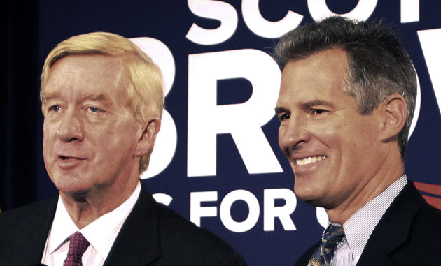 FILE - In this Oct. 5, 2012 file photo, then-Sen. Scott Brown, R-Mass., right, laughs as former Massachusetts Gov. William Weld talks with reporters after Weld endorsed Brown in Boston. Weld said Mond