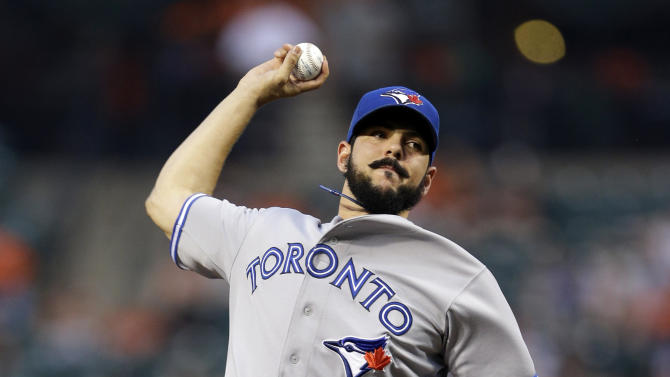 Toronto Blue Jays starting pitcher Carlos Villanueva throws to the Baltimore Orioles in the first inning of a baseball game in Baltimore, Friday, Aug. 24, 2012. (AP Photo/Patrick Semansky)
