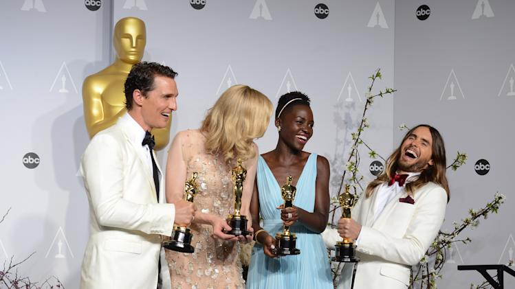 "Matthew McConaughey, from left, holds his award for best actor for his role in ""Dallas Buyers Club"", Cate Blanchett holds her award for best actress in ""Blue Jasmine"", Lupita Nyong'o holds her award for best supporting actress for ""12 Years a Slave,"" and Jared Leto holds his award for best supporting actor in ""Dallas Buyers Club"" in the press room during the Oscars at the Dolby Theatre on Sunday, March 2, 2014, in Los Angeles. (Photo by Jordan Strauss/Invision/AP)"