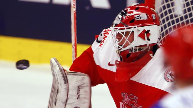 Denmark's goaltender Dahm makes a save during their ice hockey World Championship game against Russia in Ostrava