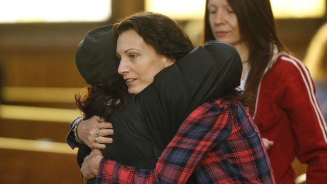 Unidentified women hug at a vigil inside a church to mark Friday's shooting at a Planned Parenthood clinic Saturday, Nov. 28, 2015, in Colorado Springs, Colo. (AP Photo/David Zalubowski)