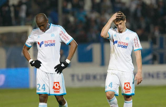 Marseille's French defender Rod Fanni, left and  Brazilian defender Lucas Mendes look dejected after losing against Nice, during their League One soccer match, at the Velodrome Stadium, in Marseil
