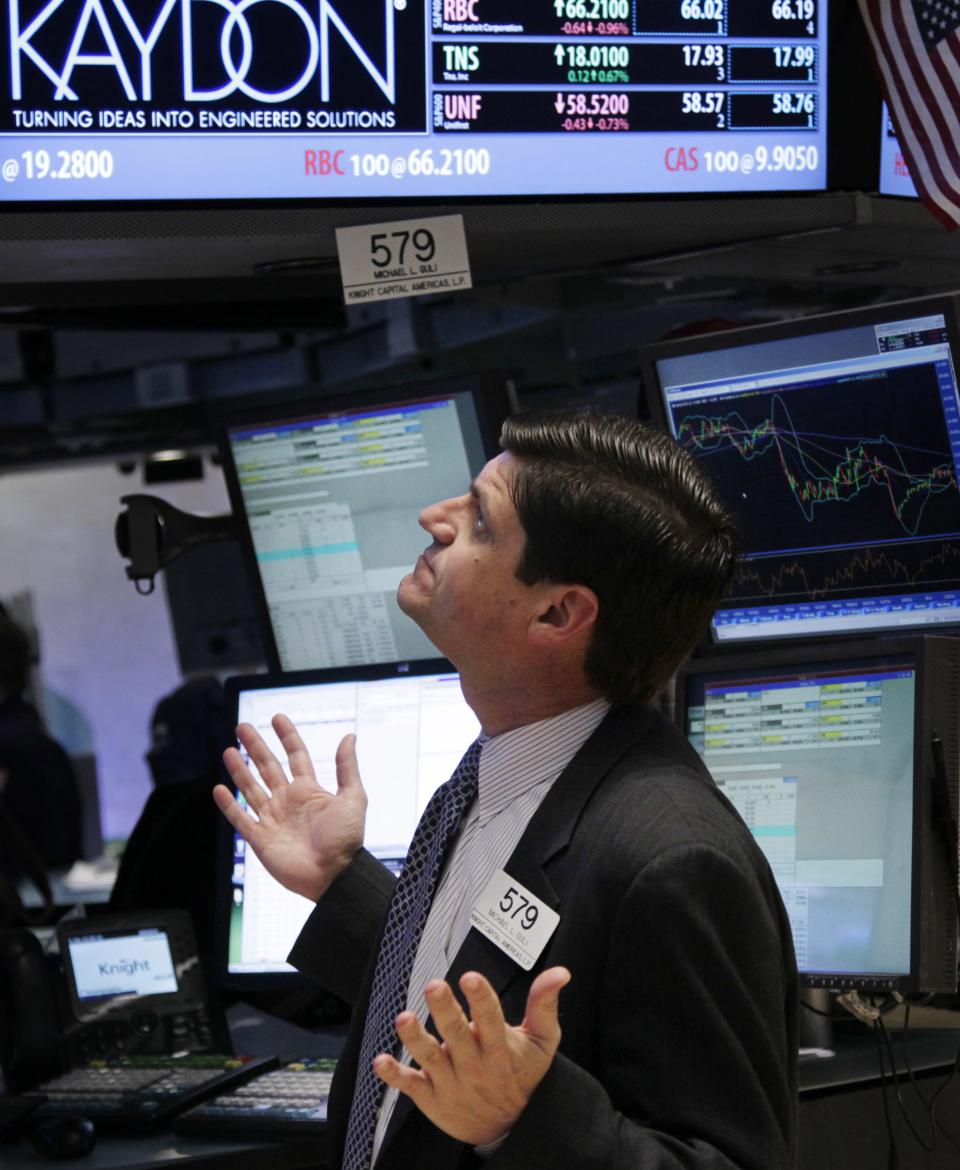 A trader gestures on the floor at the New York Stock Exchange in New York, Tuesday, March 6, 2012. Stocks in the U.S. are down more than 1 percent at the opening bell, following similar declines in Europe. (AP Photo/Seth Wenig)