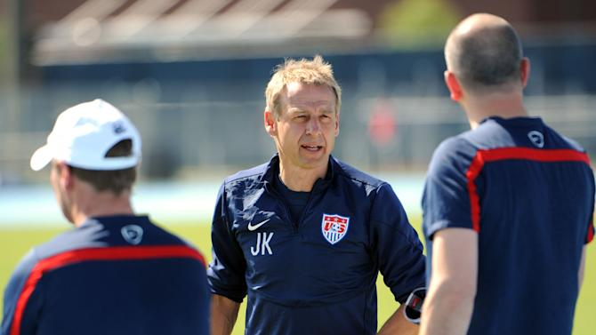 U.S.head coach Jurgen Klinsmann talks with his assistant coaches before the practice begins, Wednesday, June 4, 2014 in Jacksonville, Fla..  The team was practicing in advance of Saturday's friendly match against Nigeria, the last before the World Cup matches in Brazil