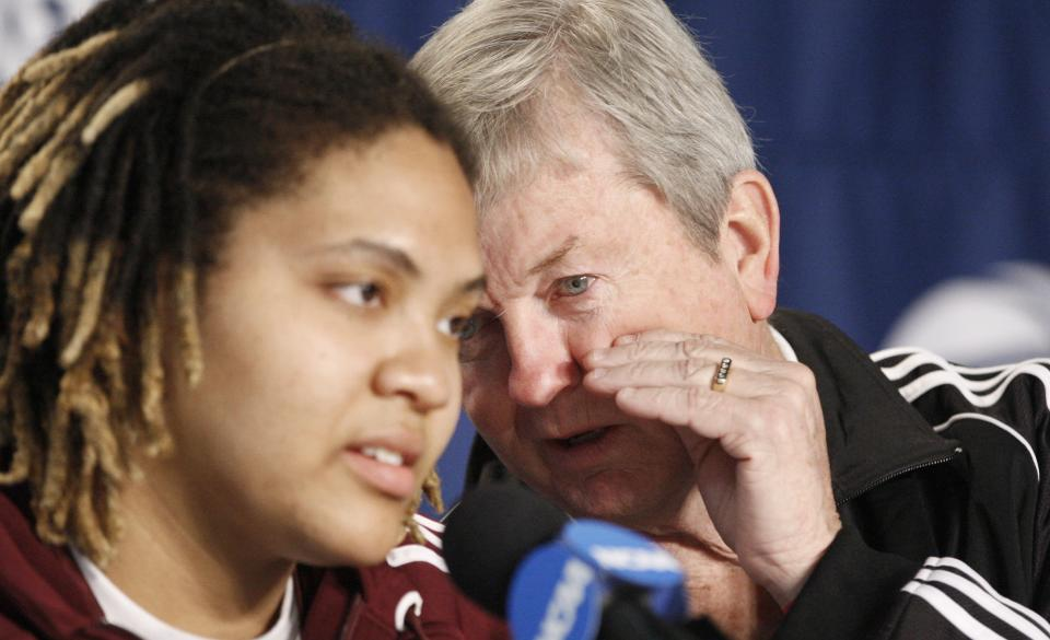 Texas A&M head coach Gary Blair talks with Danielle Adams during a news conference before the NCAA women's college basketball tournament regional final, Monday, March 28, 2011, in Dallas.  Texas will face Baylor on Tuesday. (AP Photo/LM Otero)