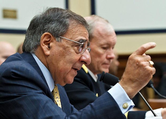 Defense Secretary Leon Panetta, left, accompanied by Joint Chiefs Chairman Gen. Martin Dempsey, testifies on Capitol Hill in Washington, Thursday, April, 19, 2012, before the House Armed Services Committee hearing on recent developments with the crisis in Syria. (AP Photo/J. Scott Applewhite)